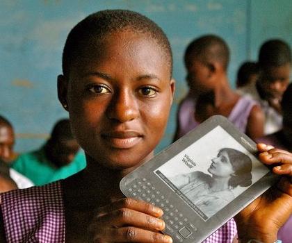 Girl in Ghana Africa with WorldReader Amazon Kindle